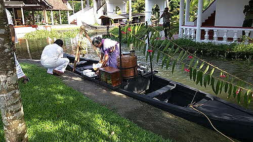 Coconut Lagoon Teaboat serves afternoon tea