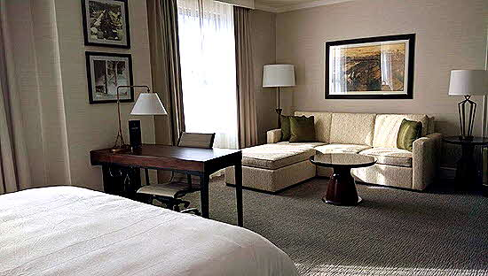 Marriott Syracuse Hotel guest rooms set up with sleeping, working, relaxing areas