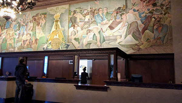 Marriott Syracuse Hotel mural over reception desk pictures city highlights